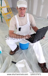 stock-photo-painter-taking-a-break-from-work-to-check-e-mails-126537971